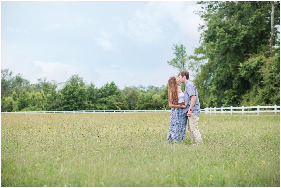 couple in beautiful field at back bay farms
