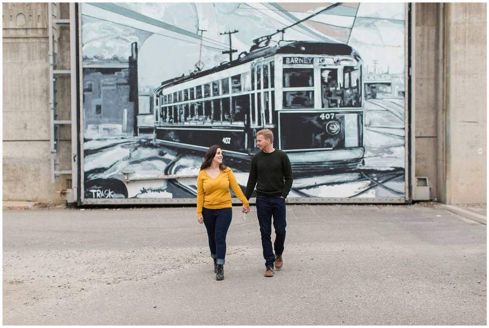 couple posing by train mural Richmond virginia