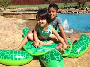 kids on turtle in texas