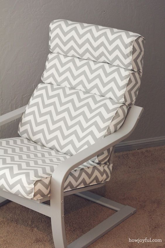 ikea poang chair in grey color and with a chevron cover