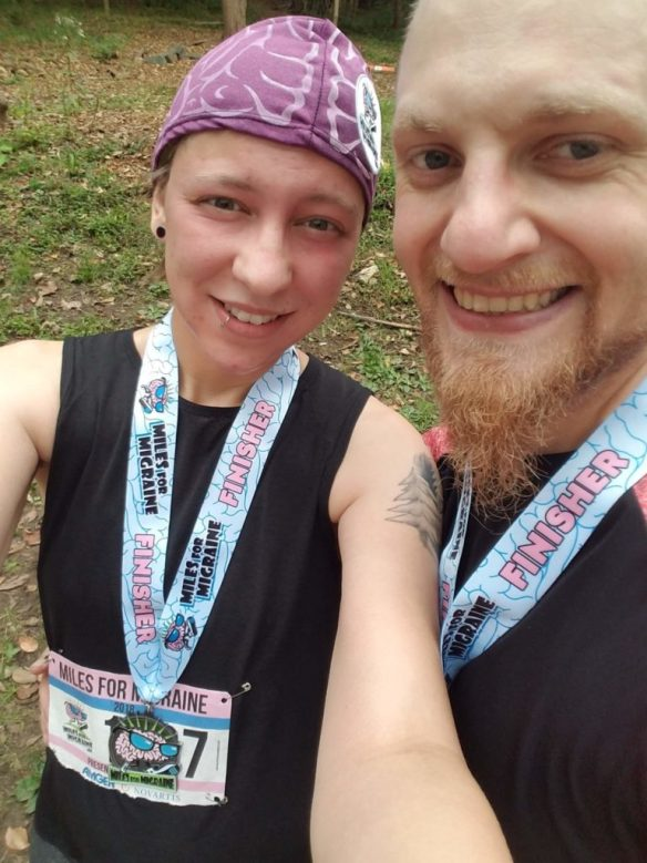Me and D.J. with our Miles for Migraine race finisher medals.