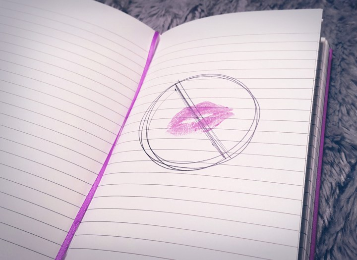 lipstick kiss on notepaper with a cross out symbol to indicate mono or the kissing disease