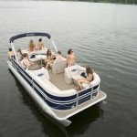 Kelowna Boat Rentals - Group of Young People RIding in Pontoon Boat