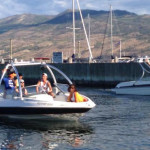 Kelowna Boat Rentals - Group of Young Adults Driving a Boat into a Boat Launch