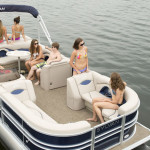 Kelowna Boat Rentals - 9 Young Adults Riding on a Pontoon Boat