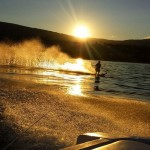 Kelowna Boat Rentals - Man Water-Sking While Sun is Setting