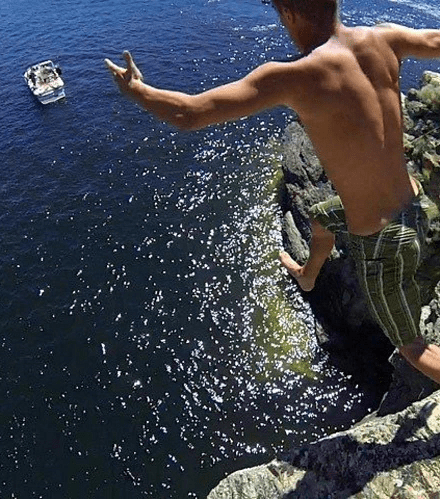 Cliff jumping from Squally Point accross the lake near Peachland and Okanagan Mountain Provincial Park.