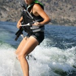 Woman Wake-boarding with Kelowna Boat Rentals