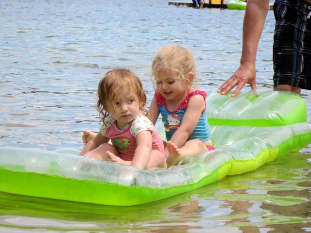 Eily and Rayleigh on a raft at Cape Cod