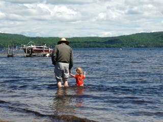 Grandpa Luke and Dillon looking at the boats on Lake Champlain.