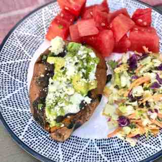 Stuffed Sweet Potato with Spiced Black Beans & Cumin Yogurt Sauce