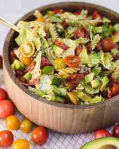 big bowl of pasta salad with bacon, lettuce, tomatoes, and avocado