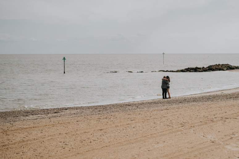 Image by an Essex proposal photographer of a marriage proposal on the beach in Holland On Sea.