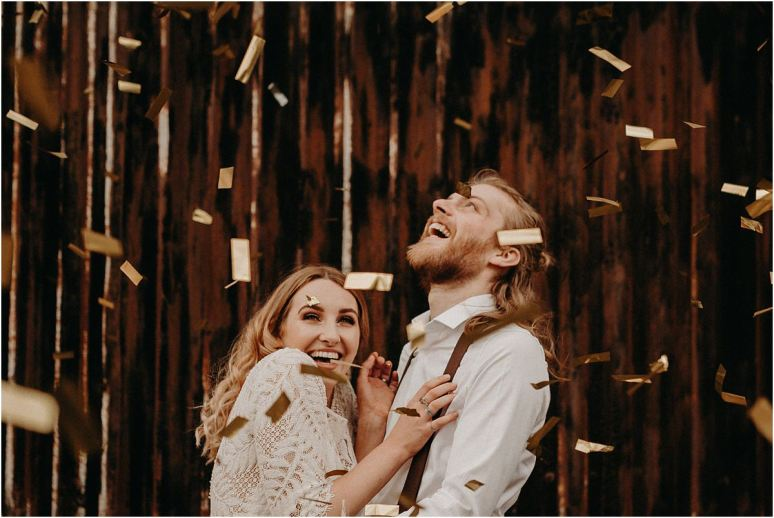Bride and groom showered in gold confetti on their Essex boho wedding day