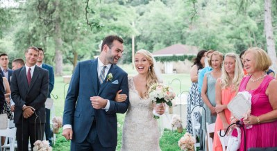 brighton wedding photographer groom walks bride down aisle
