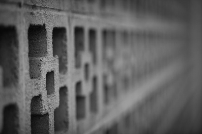 Decorative block wall, in focus in foreground, blurry at a distance