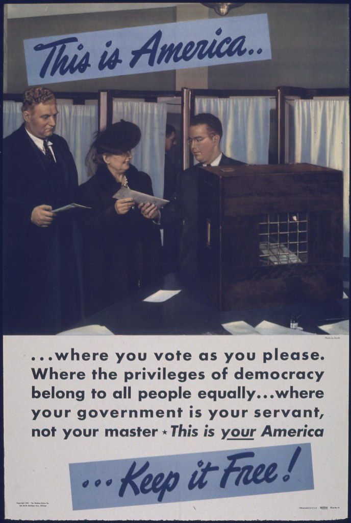 "WWII era poster showing voters at a polling station, with the message: ""This is America... where you vote as you please. Where the privileges of democracy belong to all people equally... where your government is your servant, not your master. This is your America... Keep it Free!"""