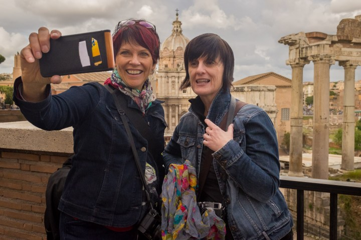 Karen Hutton and Valerie Jardin recording a short video near the Roman Forum in Rome