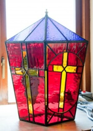 Large Lantern, stained glass lantern with two amber crosses on a red background, green oak leaf on an amber background and blue top with finial.