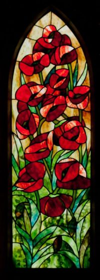 Gothic Poppies framed stained glass panel, designed by David Kennedy, Uroboros and Youghiogheny Art Glass.