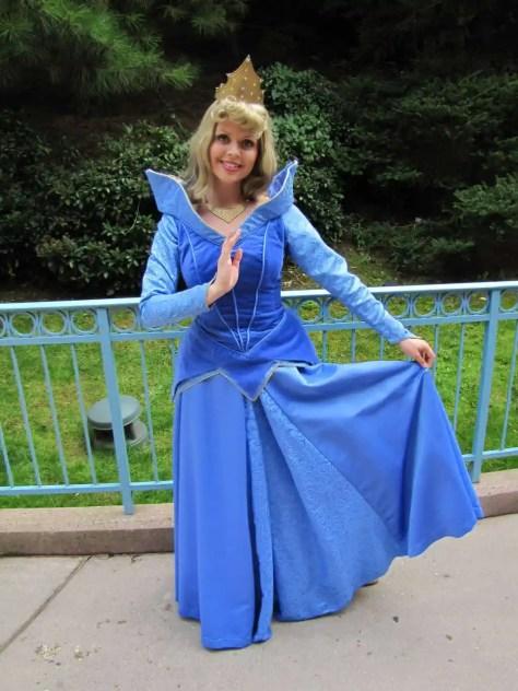 In Paris Aurora meets guests in her blue dress