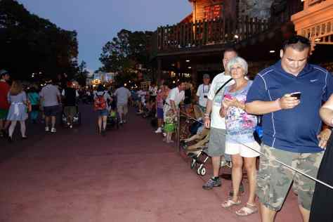 People lining up for the Boo to You parade at 7:52 PM in Frontierland. The parade begins over here, so it's a good location. Is that guy using my app???