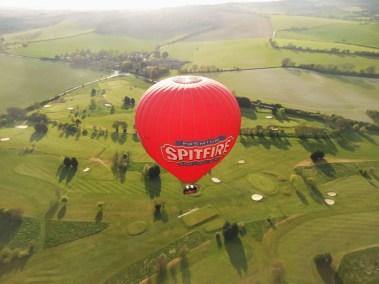 Kent Ballooning | Spitfire balloon over golf course