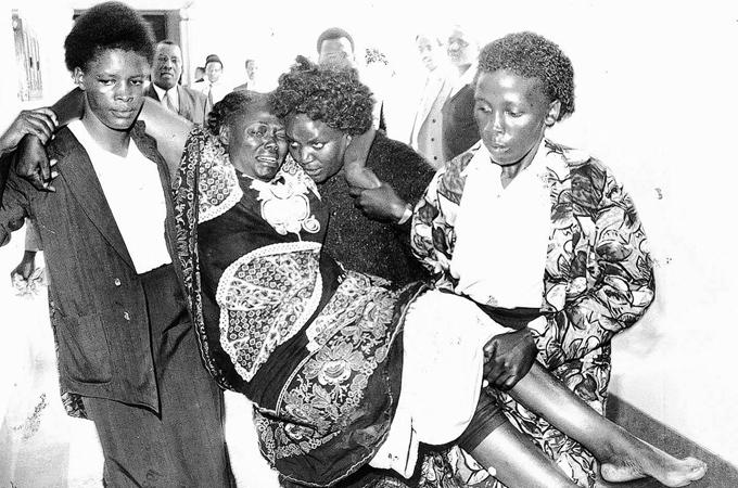 A wounded Wangari in tears after a demonstration gone bad.