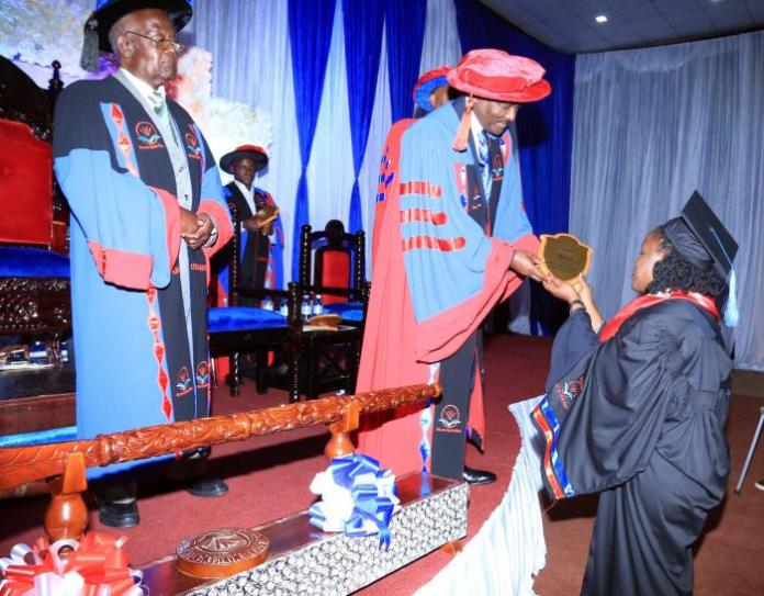 Wiper Leader Kalonzo Musyoka Wards a student at the Uganda Technology And Management University (UTAMU)' 4th Graduation Ceremony at the Silver Springs, Kampala on September 29, 2018.