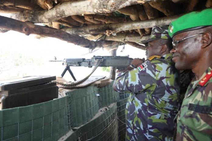 Mwathethe tries his hand at one of the KDF weaponry at the Kuday Forward Operating Base (FOB) in Badhadhe District, Lower Juba in Somalia on Sunday, December 22.
