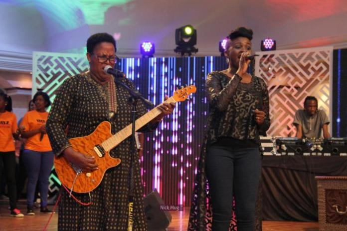 Mercy Masika (R) and her mother Agnes Masika performing together.