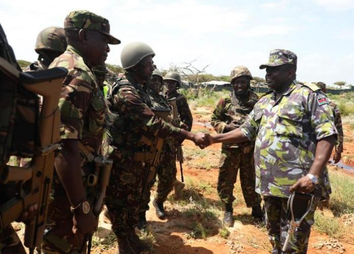 KDF soldiers meeting General Samson Mwathethe in Somalia on Sunday, December 22.