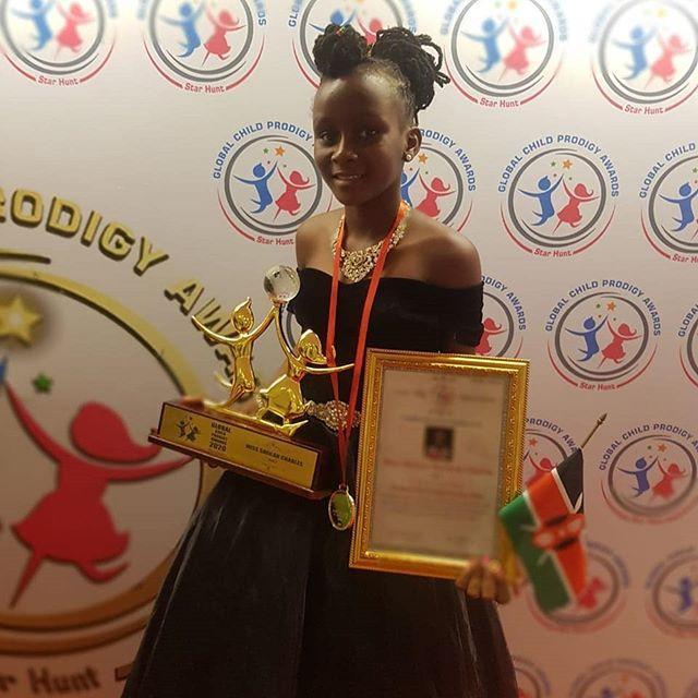 Kenyan child prodigy Sheila Sheldon poses for a photo after winning