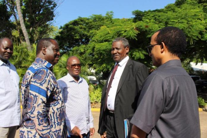AU Special Envoy Raila Odinga flanked by Infrastructure CS James Macharia (in white shirt) in Mombasa on Tuesday, January 14.