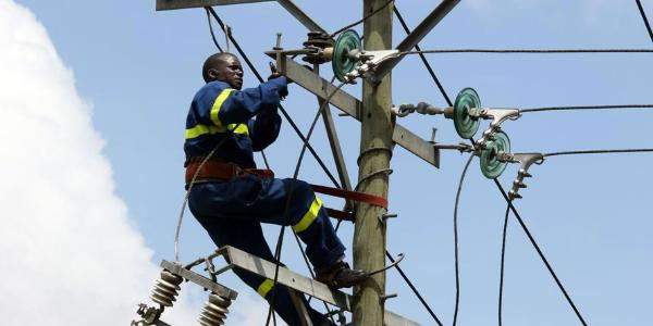 A technician from KPLC at work in Nairobi.