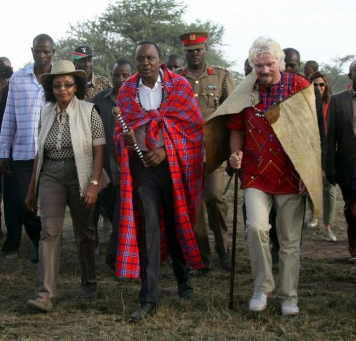 British billionaire Richard Branson with President Uhuru Kenyatta on October 27, 2013, when he officially opened his Mahali Mzuri Safari Camp.