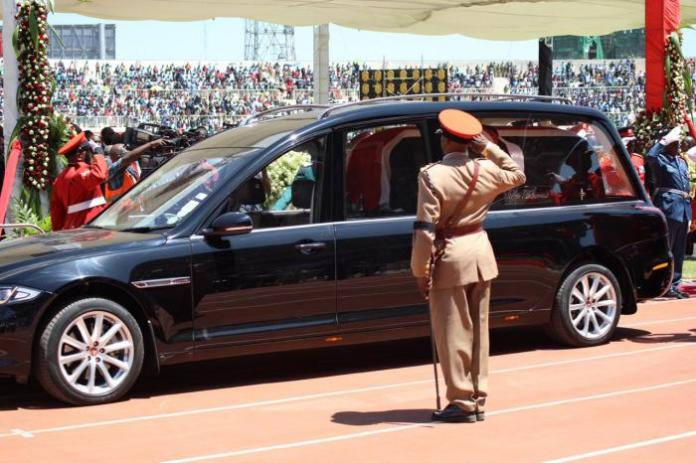 The late President Daniel arap Moi's body is ferried out of Nyayo National Stadium in a Jaguar XJ limousine on February 11.
