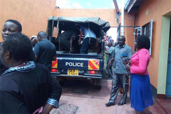 Police take away the body of a man who was allegedly stabbed and killed by his wife in Nakuru's Gorofa Estate on December 12, 2019.