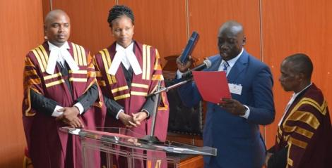 Deceased Kahawa Wendani MCA Cyrus Omondi(Second RIght) takes oath of office at the Kiambu County Assembly in August 2017