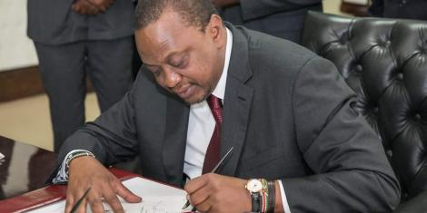 https://www.kenyans.co.ke/President Uhuru Kenyatta signs the Finance Bill 2018 at State House, Nairobi.