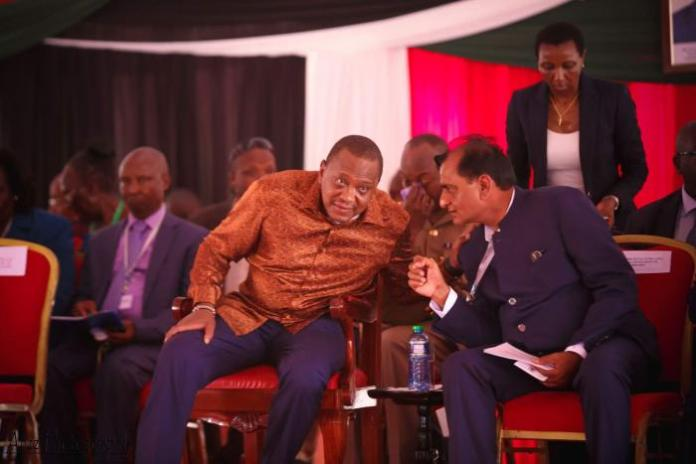 Devki Group founder Narendra Raval (Right) chats with President Uhuru Kenyatta when he opened a cement plant in Kajiado in January 2018