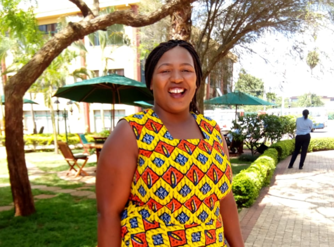 Celine Njoki Mbithi smiles for the camera during an interview.