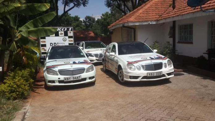 A fleet of luxury cars branded with messages in support of the Building Bridges Initiative and Nairobi Governor Mike Sonko pictured on Wednesday, February 26