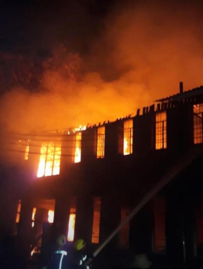 A fire destroys buildings at Starehe Boys Centre in Nairobi on February 15, 2020.