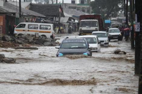 Vehicles navigate a flooded road in Mombasa.