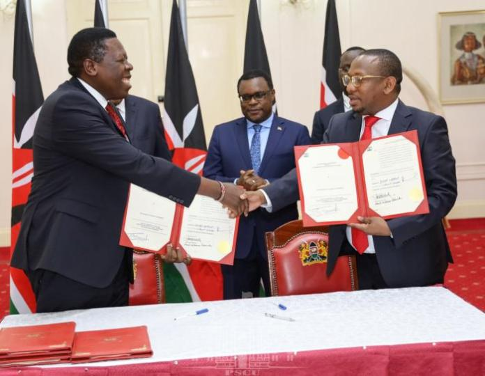 Nairobi Governor Mike Mbuvi Sonko and Devolution CS Eugene Wamalwa shake hands after the signing of the agreement in which functions of the Nairobi County Government were handed to the National Government on Tuesday, February 25 at State House.