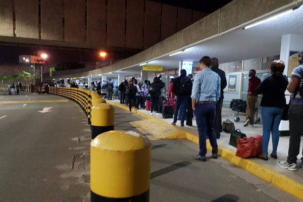 Passengers pictured at the Jomo Kenyatta International Airport (JKIA) following a disruption on March 6, 2019