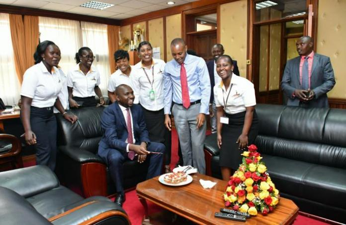 A photo of the Senate Majority leader Kipchumba Murkomen (seated) with staff at his office during a surprise birthday party at his offices on Thursday, March 12.