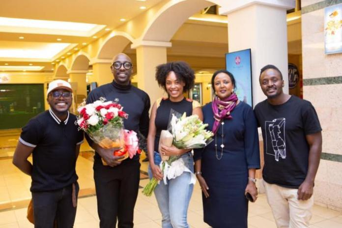From left: Delvin Mudigi, Bien Aime, Chiki Kuruka, Sports CS Amina Mohamed and Willis Chimano pose for a photo after Bien proposed to Chiki in February 2019