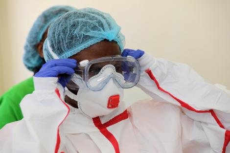A medical practitioner dresses in protective gear at Coronavirus isolation and treatment facility in Mbagathi District Hospital on Friday, March 6, 2020.